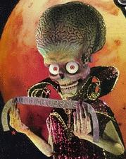 http://johnstodderinexile.files.wordpress.com/2006/09/mars_attacks-alien.jpg